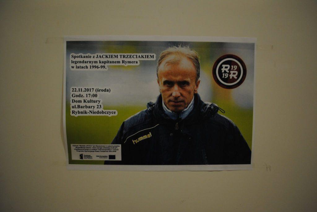 plakat zapraszający na spotkanie z Jackiem Trzeciakiem